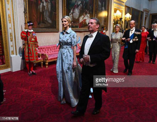 Ivanka Trump and Secretary of State for International Trade Liam Fox arrive through the East Gallery for a State Banquet at Buckingham Palace on June...