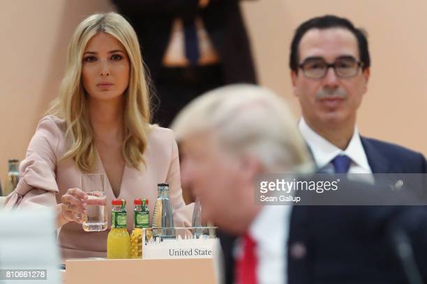 Ivanka Trump and US Treasury Secretary Steven Mnuchin look on as US President Donald Trump arrives for the morning working session on the second day...