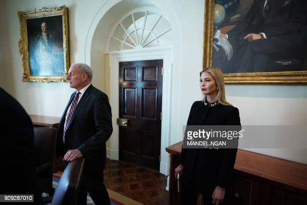 Ivanka Trump and White House Chief of Staff John Kelly attend a Cabinet meeting in the Cabinet Room of the White House on March 8 2018 in Washington...