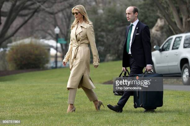 Ivanka Trump and White House Senior Advisor Stephen Miller walk across the South Lawn before departing the White House with US President Donald Trump...