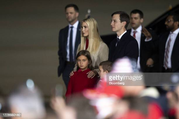 Ivanka Trump, assistant to U.S. President Donald Trump, and Jared Kushner, senior White House adviser, listen with their children Arabella and...