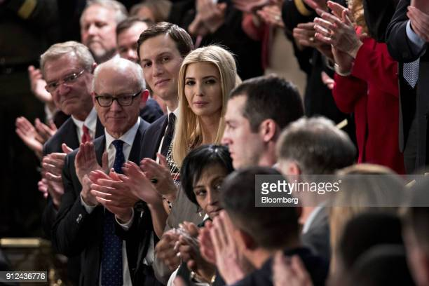 Ivanka Trump assistant to US President Donald Trump center and Jared Kushner senior White House adviser center left clap as guests are introduced...