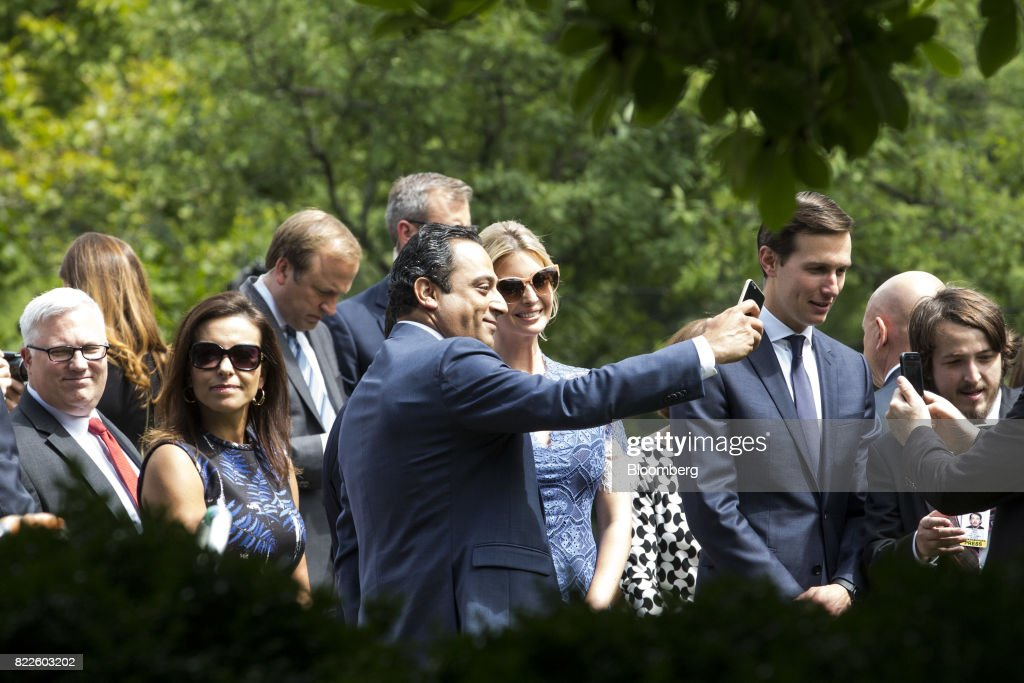 Ivanka Trump, assistant to U.S. President Donald Trump, center right, stands for a selfie photograph with an attendee before the start of a joint press conference with Trump and Saad Hariri, Lebanon's prime minister, not pictured, in the Rose Garden of the White House in Washington, D.C., U.S., on Tuesday, July 25, 2017. Trump said he's disappointed with Attorney General Jeff Sessions for recusing himself from investigations of Russian interference in the 2016 election, and that 'time will tell' if the nation's top law enforcement officer remains in his job. Photographer: Zach Gibson/Bloomberg via Getty Images