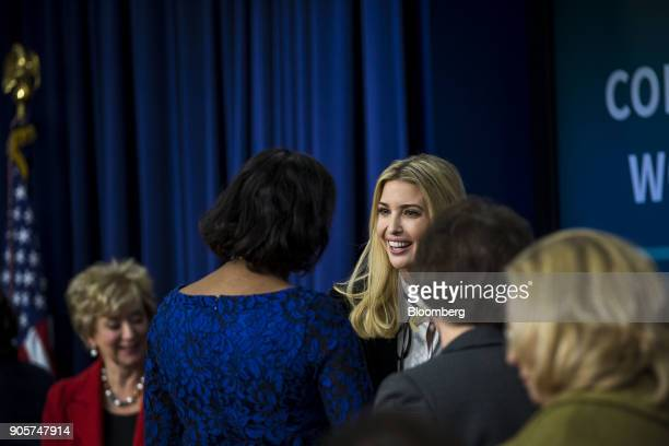 Ivanka Trump assistant to US President Donald Trump center speaks with an attendee during a 'Conversations with the Women of America' event at the...