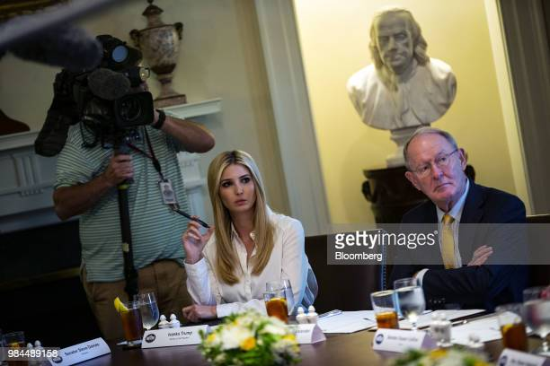 Ivanka Trump assistant to US President Donald Trump left and Senator Lamar Alexander a Republican from Tennessee listen during a lunch meeting witt...
