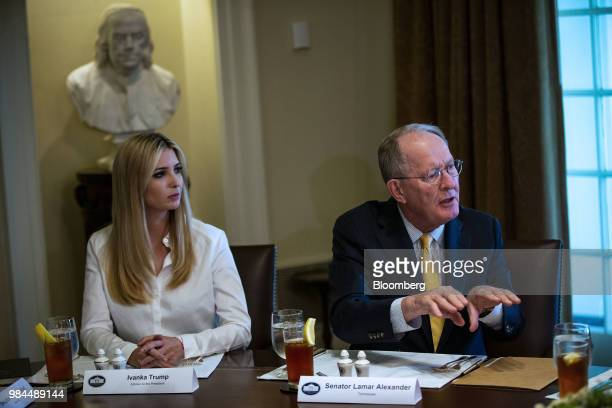 Ivanka Trump assistant to US President Donald Trump left listens while Senator Lamar Alexander a Republican from Tennessee speaks during a lunch...