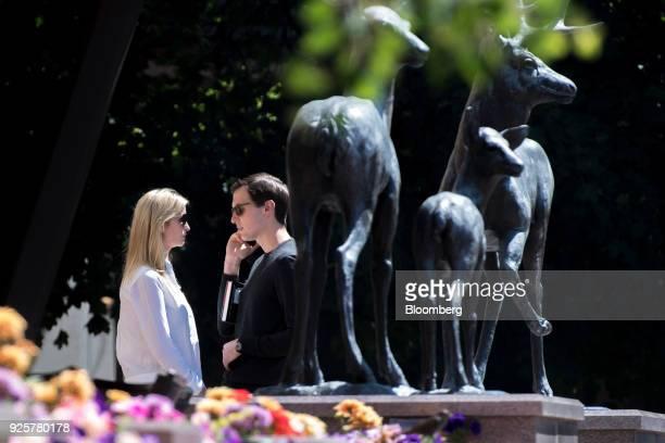 Ivanka Trump assistant to US President Donald Trump left stands outside with her husband Jared Kushner senior White House adviser after the morning...