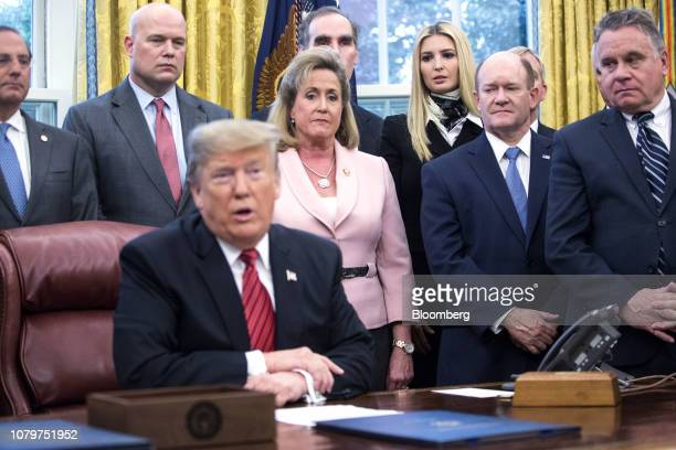 Ivanka Trump assistant to US President Donald Trump listens during a signing ceremony for antihuman trafficking legislation with President Trump in...