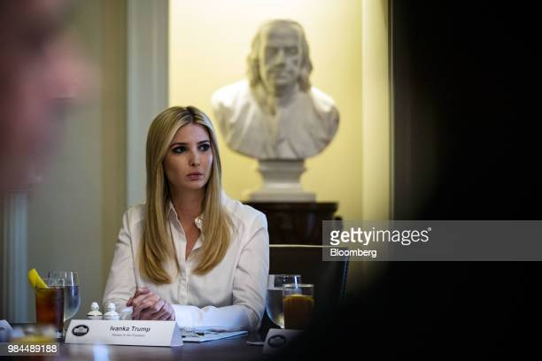 Ivanka Trump assistant to US President Donald Trump listens during a lunch meeting with Republican lawmakers in the Cabinet Room of the White House...