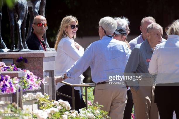 Ivanka Trump assistant to US President Donald Trump second from left speaks with attendees after a morning session during the Allen Co Media and...