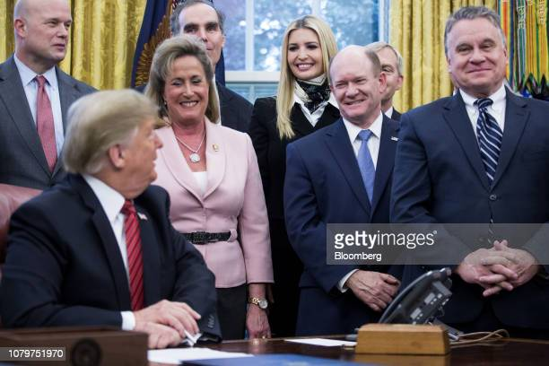 Ivanka Trump assistant to US President Donald Trump smiles during a signing ceremony for antihuman trafficking legislation with President Trump in...