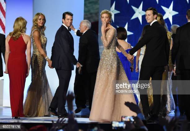 Ivanka Trump blows a kiss to the crowd as she leaves the stage with her husband Jared Kushner and her brother Donald Trump Jr and his wife Vanessa...