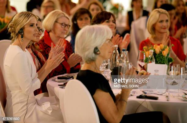 Ivanka Trump daughter and adviser of US President Donald Trump listens to a speech of German Chancellor Angela Merkel during a dinner after she...