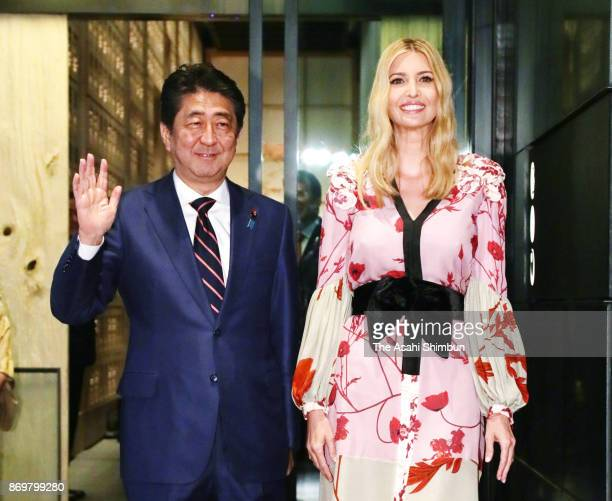 Ivanka Trump daughter and advisor of the US president Donald Trump poses for photographs with Japanese Prime Minister Shinzo Abe prior to their...