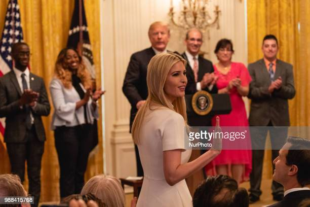Ivanka Trump daughter and assistant to US President Donald Trump stands as she's acknowledged by President Trump during his event celebrating the...