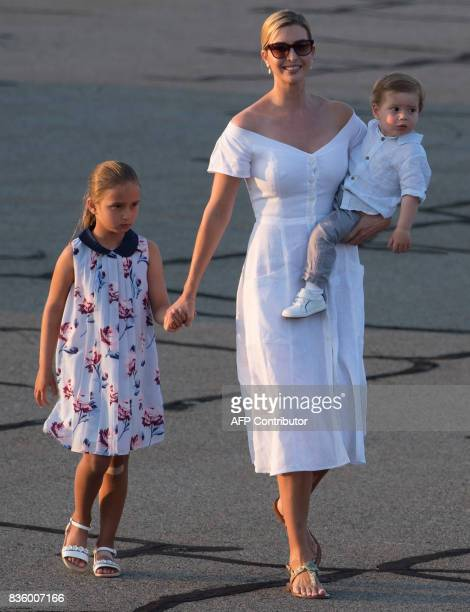 Ivanka Trump daughter of US President Donald Trump along with her children Arabella and Theodore walk to board Air Force One prior to departure...