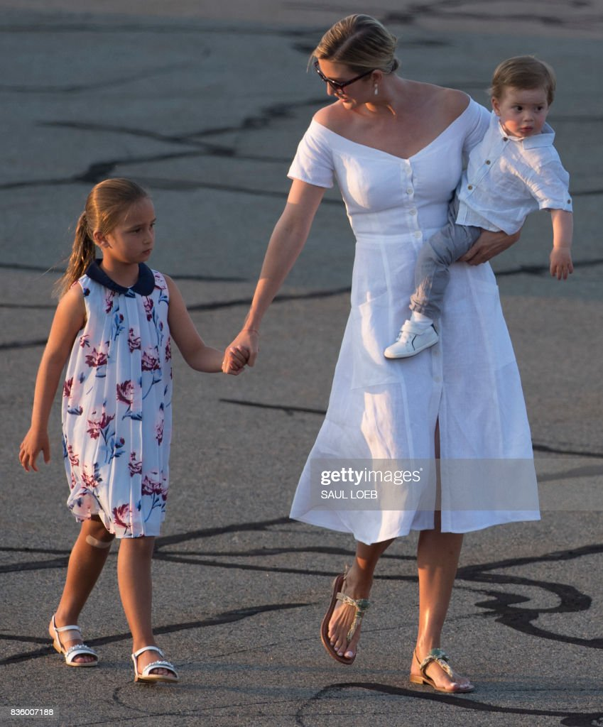 Ivanka Trump, daughter of US President Donald Trump, along with her children, Arabella (L) and Theodore, walk to board Air Force One prior to departure Morristown Municipal Airport in Morristown, New Jersey, August 20, 2017, as Trump returns to Washington, DC, following a 17-day vacation at his property in Bedminster, New Jersey. /