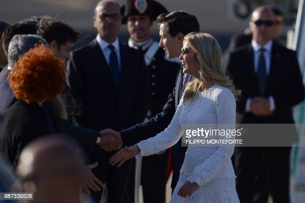 Ivanka Trump daughter of US President Donald Trump and her husband Jared Kushner senior adviser to Trump are welcomed by officials upon their arrival...