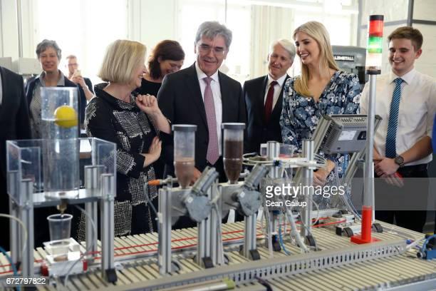 Ivanka Trump daughter of US President Donald Trump CEO Siemens Joe Kaeser and German Minister for Education Johanna Wanka look at a machine built by...