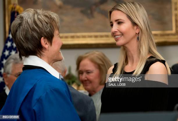 Ivanka Trump daughter of US President Donald Trump speaks with NASA Astronaut Peggy Whitson following a signing ceremony for Space Policy Directive 1...
