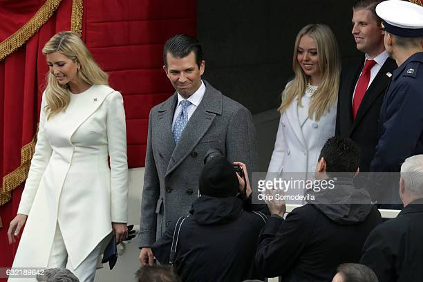 Ivanka Trump Donald Trump Jr Tiffany Trump and Eric Trump arrive on the West Front of the US Capitol on January 20 2017 in Washington DC In today's...