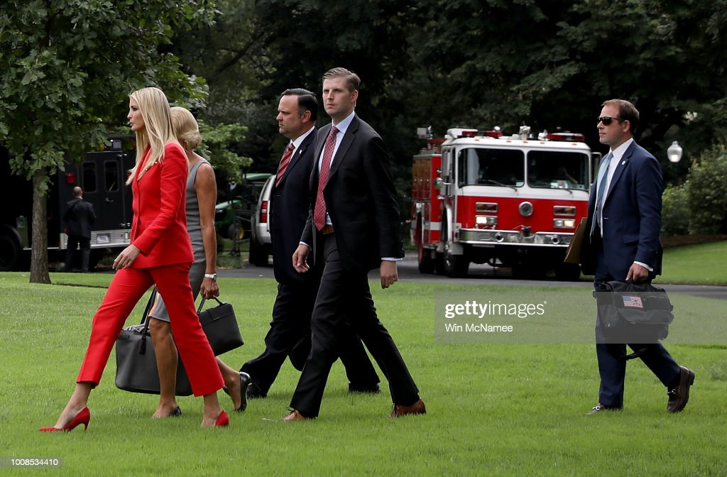 Ivanka Trump, Education Secretary Betsy DeVos, White House Director of social media Dan Scavino, Eric Trump, and Director of Oval Office operations Jordan Karem walk across the White House south lawn as they depart with U.S. President Donald Trump July 31, 2018 in Washington, DC. President Trump is scheduled to travel to Tampa, Florida where he will attend a campaign rally for Rep. Ron DeSantis (R-FL), who is running for governor.