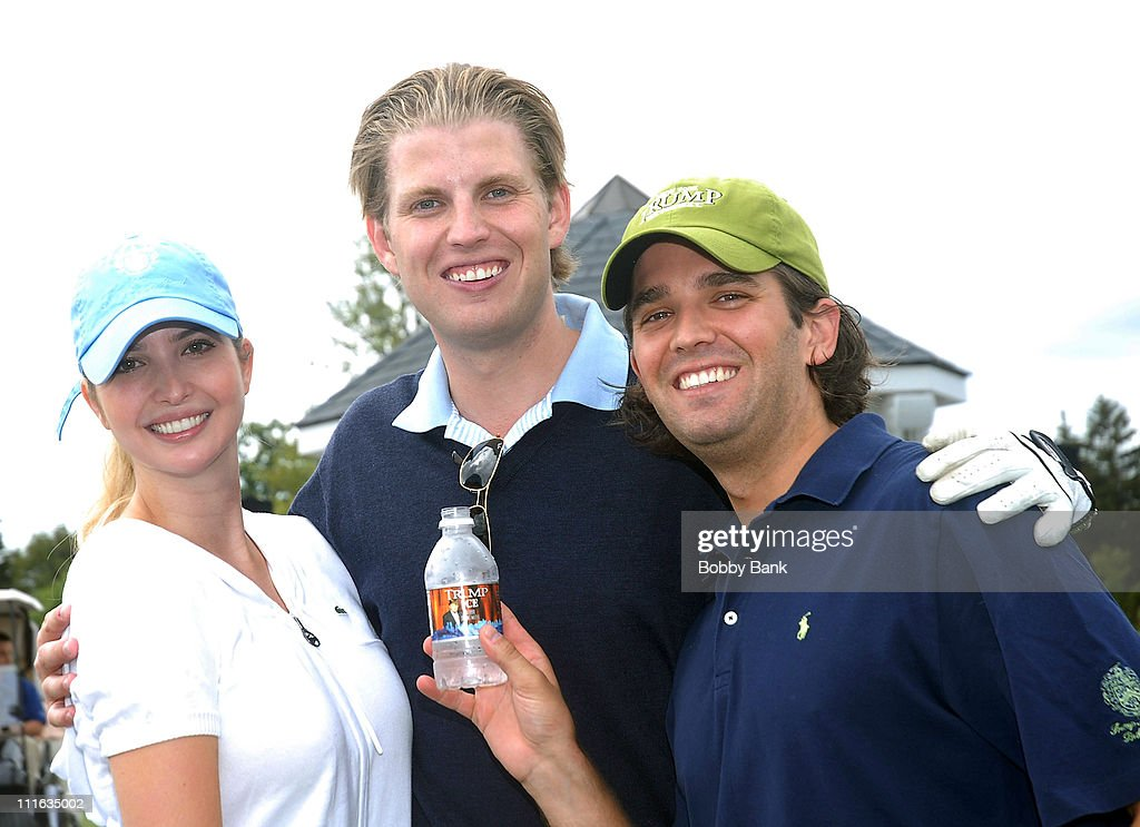 Ivanka Trump, Eric Trump and Donald Trump Jr. pose with a bottle of Trump Ice Water at the 2008 Eric Trump Foundation Golf Outing at the Trump National Golf Club on September 16, 2008 in Westchester, New York.