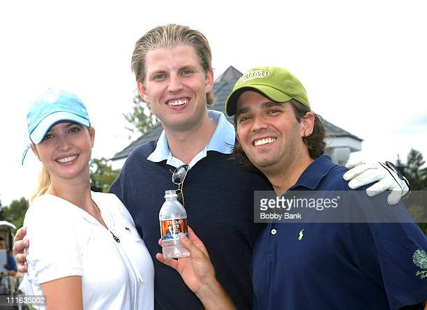 Ivanka Trump Eric Trump and Donald Trump Jr pose with a bottle of Trump Ice Water at the 2008 Eric Trump Foundation Golf Outing at the Trump National...