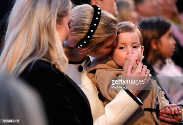 Ivanka Trump gives her son Theodore a kiss on the cheek at the 95th Annual National Christmas Tree Lighting Ceremony in President's Park on November...