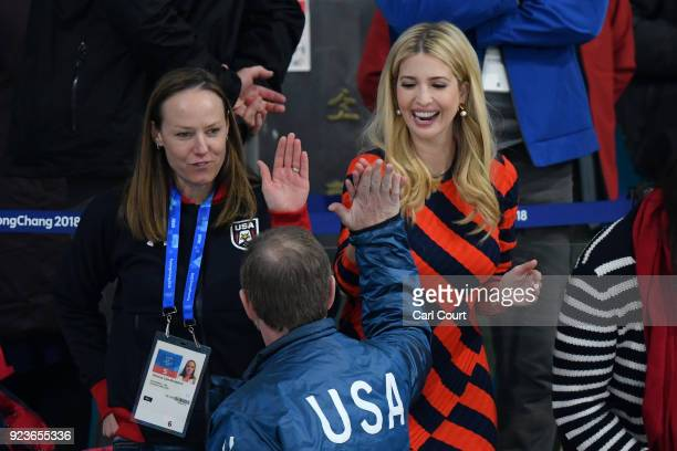 Ivanka Trump high fives a spectator after the United States of America beat Sweden in their Men's Gold Medal Curling match next to former Olympic US...