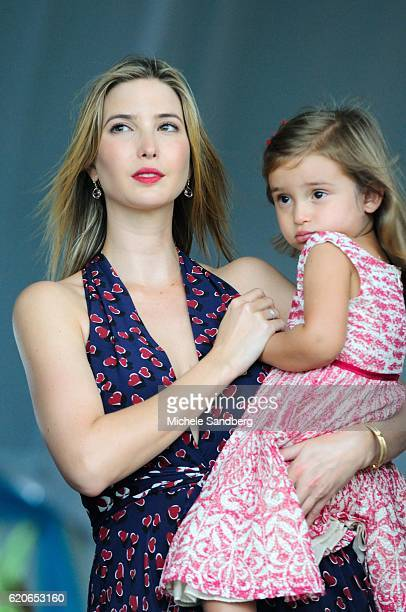 Ivanka Trump holds her daughter Arabella Rose at the $125000 Trump Invitational Grand Prix presented by Rolex showcase 36 of the world's top riders...