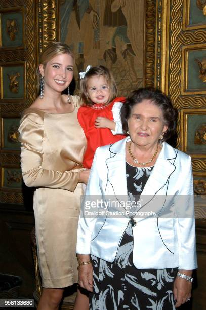 Ivanka Trump holds her niece Kai Madison while standing with her grandmother Marie Zelnickova at the MarALago estate Palm Beach Florida on...