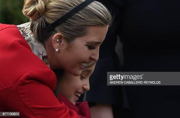 Ivanka Trump hugs her daughter Arabella Rose Kushner before the turkey pardoning ceremony at the White House in Washington DC on November 21 2017 /...