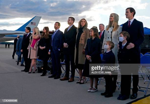 Ivanka Trump , husband Jared Kushner , their children, Eric and Donald Jr. And Trump family members stand on the tarmac at Joint Base Andrews in...