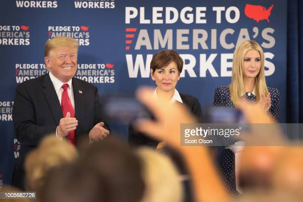 Ivanka Trump Iowa Governor Kim Reynolds and President Donald Trump participate in a round table at Northeast Iowa Community College on July 26 2018...