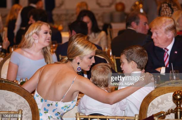 Ivanka Trump is seen with her sons Joseph Kushner and Theodore Kushner during Thanksgiving dinner with US President Donald Trump and Tiffany Trump at...