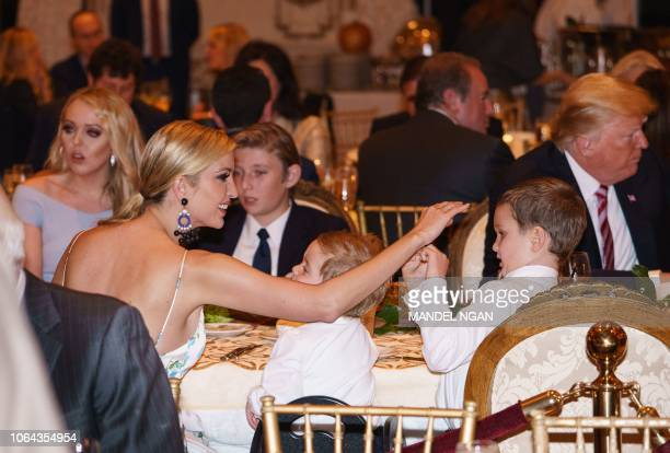 Ivanka Trump is seen with her sons Joseph Kushner and Theodore Kushner during Thanksgiving dinner with US President Donald Trump Tiffany Trump and...