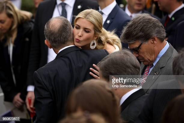 Ivanka Trump kisses Environmental Protection Agency Administrator Scott Pruitt during the state arrival ceremony hosted for French President Emmanuel...