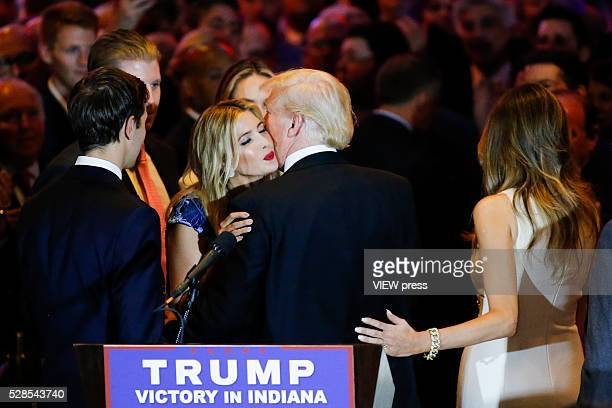 Ivanka Trump kisses her father Republican presidential front runner Donald Trump after he spoke to supporters and the media at Trump Tower in...