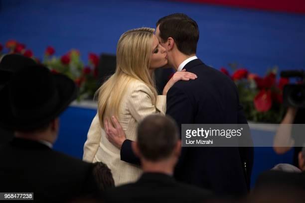 Ivanka Trump kisses White House senior advisors Jared Kushner during the opening of the US embassy in Jerusalem on May 14 2018 in Jerusalem Israel US...