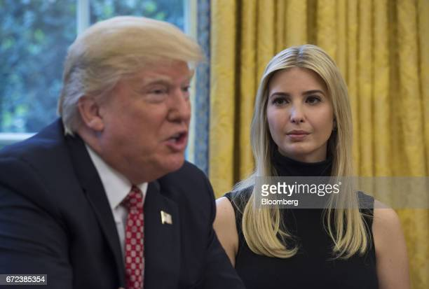 Ivanka Trump listens as her father US President Donald Trump speaks while holding a video conference to the International Space Station with NASA...