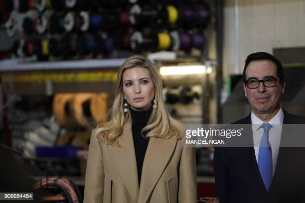 Ivanka Trump listens with US Treasury Secretary Steven Mnuchin as US President Donald Trump tours the HK Equipment Company in Coraopolis Pennsylvania...