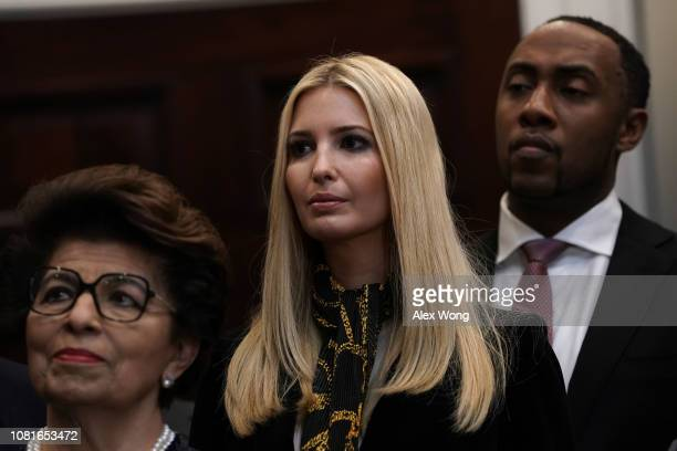 Ivanka Trump looks on as her father and US President Donald Trump participates in signing an executive order to establish the White House Opportunity...