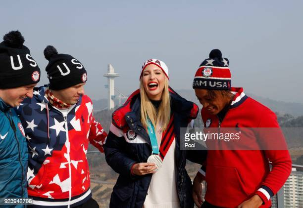 Ivanka Trump poses with US athletes Taylor Morris Matt Mortensen and Lauren Gibbs on day sixteen of the PyeongChang 2018 Winter Olympic Games on...