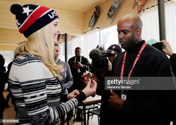 Ivanka Trump presents Garrett Hines with a medal from her father while visiting the USA House on February 24 2018 in Pyeongchanggun South Korea