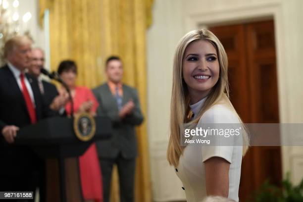 Ivanka Trump senior adviser and daughter of US President Donald Trump attends an event at the East Room of the White House June 29 2018 in Washington...