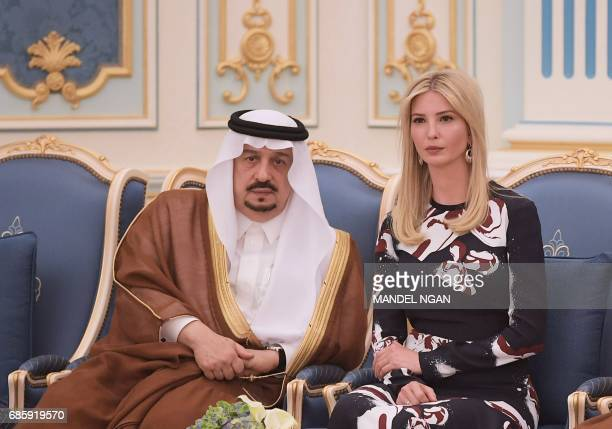 Ivanka Trump sits next to Prince Faisal bin Bandar the governor of the Saudi capital Riyadh during a ceremony where her father US President Donald...