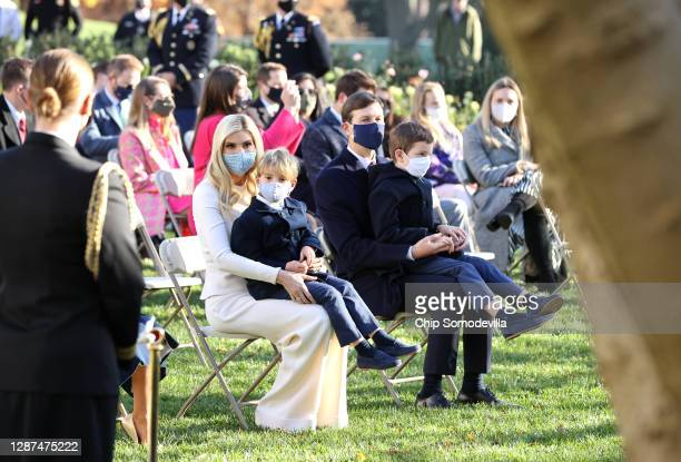 Ivanka Trump sits with her son Theodore Kushner and her husband Jared Kushner and son Joseph Kushner as they wait for U.S. President Donald Trump to...
