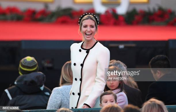 Ivanka Trump smiles before the arrival of US President Donald Trump for the 95th annual National Christmas Tree Lighting ceremony at the Ellipse in...