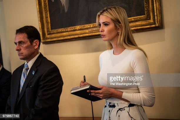 Ivanka Trump takes notes as President Donald Trump speak during a roundtable discussion with Republican Members of Congress in the Cabinet Room of...